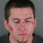 Intoxicated Man Spits At Police, Resists Arrest